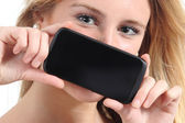 Diagonal view of a woman showing a black smartphone screen — Stock Photo