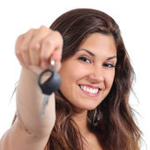 Beautiful woman smiling and holding her car key — Stock Photo