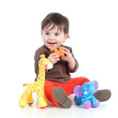 Pretty little baby girl playing with animal toys — Stock Photo