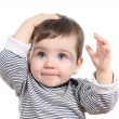 Beautiful baby girl with hand on the head — Stock Photo