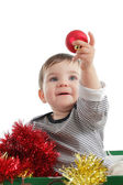 Pretty baby girl holding a christmas ball — Stock Photo