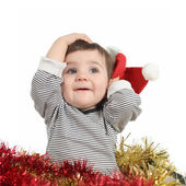 Pretty baby girl holding a santa claus hat — Stock Photo