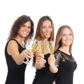 Beautiful group of three women toasting with champagne — Stock Photo