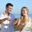 Stock Photo: Couple discussing map or smartphone gps on vacations