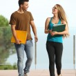 Teenager students boy and girl walking towards camera — Stock Photo