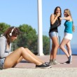 Two teen girls bullying another one — Zdjęcie stockowe