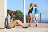Two teen girls bullying another one — Foto de Stock