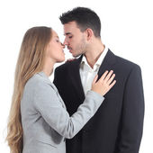 Couple of businesspeople in love ready to kiss — Stock Photo