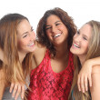 Group of three girls hugging happy — Stock Photo