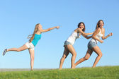 Group of teenager girls playing throwing water — Stock Photo