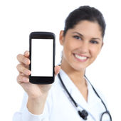 Beautiful female doctor smiling and showing a blank smart phone screen isolated — Stock Photo