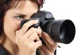 Beautiful photographer woman holding a digital camera — Stock Photo