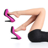 Beautiful woman legs with a fuchsia high heels dangling — Stockfoto