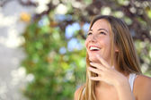 Beautiful woman laughing and looking above — Stock Photo