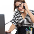 Beautiful secretary stressed at phone working in office — Stock Photo #35208025