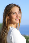 Portrait of a beautiful woman with a white perfect smile — Photo