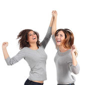 Two euphoric girls jumping — Stock Photo