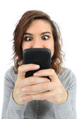 Close up of a teenager addicted to the smart phone — Stock Photo