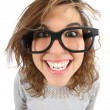 Stock Photo: Wide angle view of a geek woman with glasses smiling
