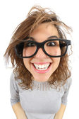 Wide angle view of a geek woman with glasses smiling — Stock Photo