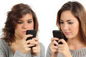Two teenagers addicted to the smart phone technology — Stock Photo
