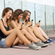 Group of teenager girls smiling happy texting on the smart phone — Stock Photo #42921083