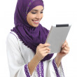 Arab happy woman reading a tablet reader — Stock Photo