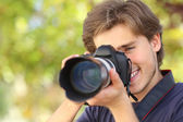Photographer photographing and learning with a dslr digital camera — Stock Photo