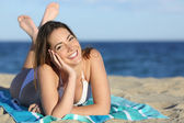 Happy woman with white perfect smile resting on the beach — Stock Photo