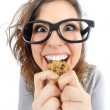 Funny geek girl eating a cookie — Stock Photo #48504423