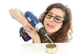 Funny geek girl trying to open a tin with a drill — Stock Photo
