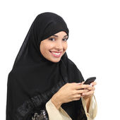 Arab saudi emirates smiling woman using a smart phone — Zdjęcie stockowe