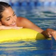 Woman bathing and playing with water on a swimming pool in vacations — Stock Photo #50849981