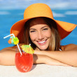 Beauty woman with perfect smile enjoying in a swimming pool on vacations — Stock Photo #50850017