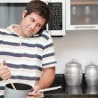 Likeable man in the kitchen talking on the phone — Stock Photo
