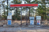 Abandoned retro gas pumps in the rural landscape — 图库照片