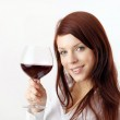 Beautiful young woman enjoying wine — Stock Photo