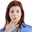 Woman with hand over mouth — Stock Photo