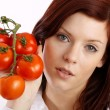 Woman holding tomatoes — Stock Photo #14755345