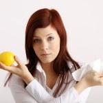 Woman holding a lemon — Stock Photo #14755359