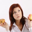 Young woman with hamburger and apple — Stock Photo #14755437