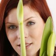 Lovely woman with green leaf — Stock Photo