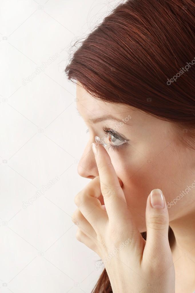 Close-up of  woman with contact lens applying   Stock Photo #14755125