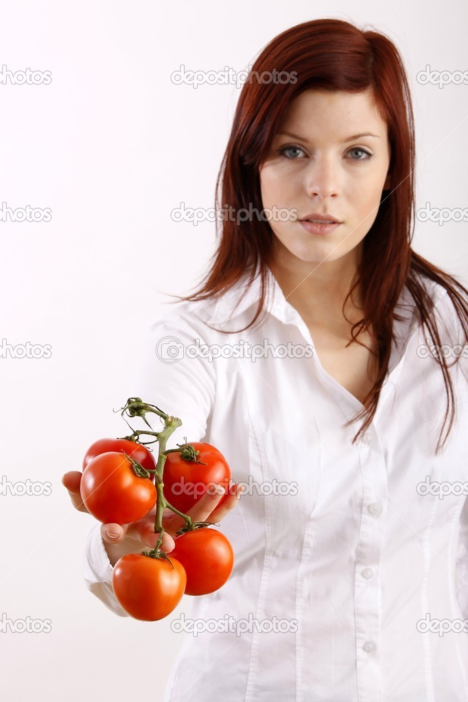Woman holding tomatoes  — Stock Photo #14755327