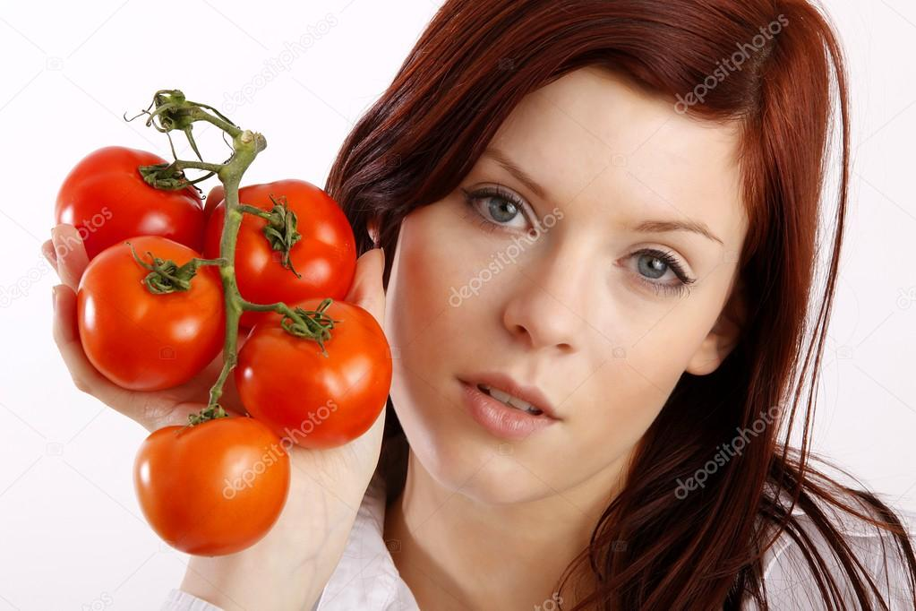 Woman holding tomatoes   Stock Photo #14755345