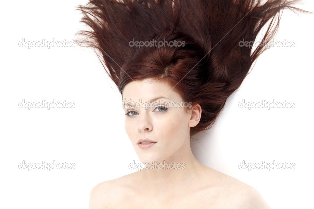 Portrait of a young woman with hair lightly fluttering in the wind on a white background — Stock Photo #14756031
