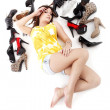 Girl lying on the floor with shoes — Stock Photo #15778661