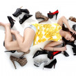 Girl lying on the floor with shoes — Stock Photo #15778673