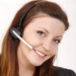 Girl talking on headphones — Stock Photo #15779025