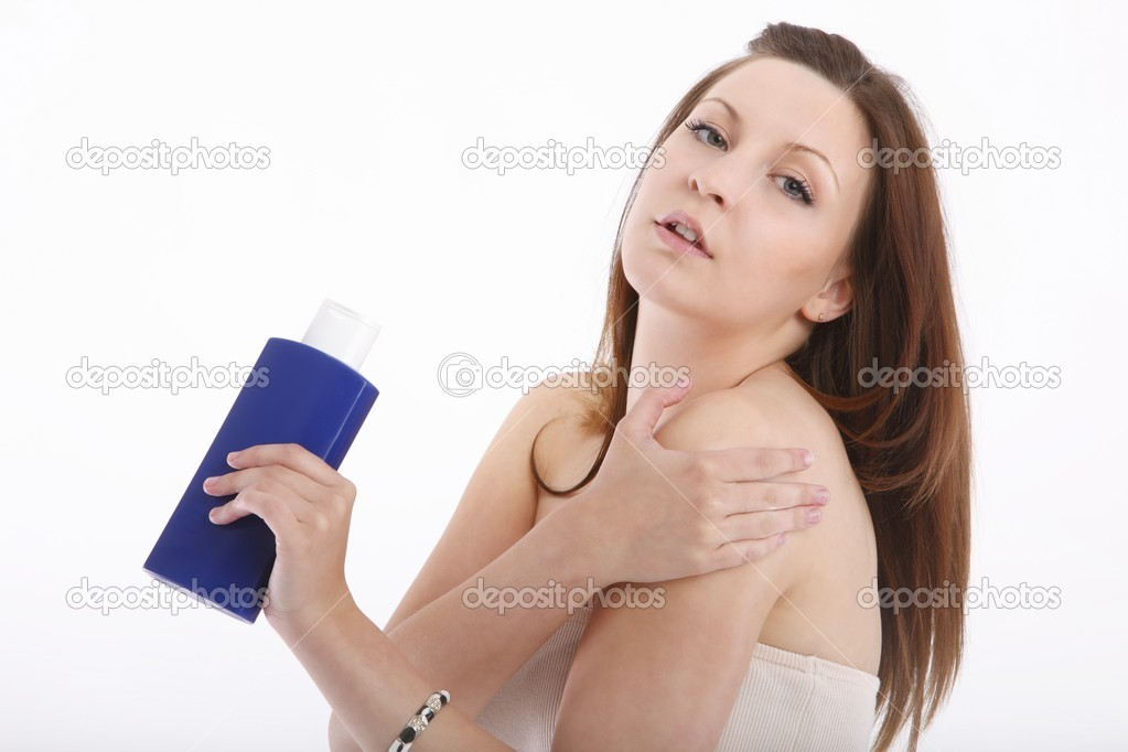 Girl in towel smeared with cream — Stock Photo #15778721